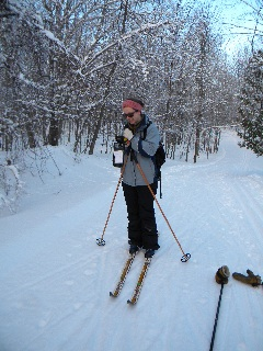 ...Or studying nature. Erica Barkley, Ontario Parks biologist, doing a deer track survey
